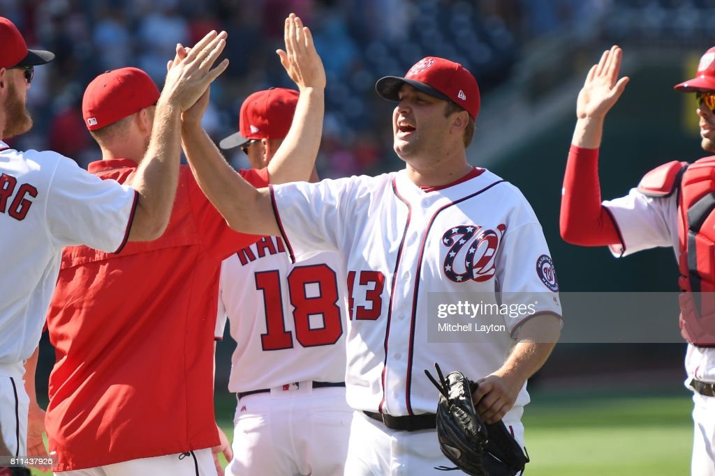 Matt Albers #43 of the Washington Nationals celebrates a win after a baseball game against the Atlanta Braves at Nationals Park on July 9, 2017 in Washington, DC. The Nationals won 10-5.