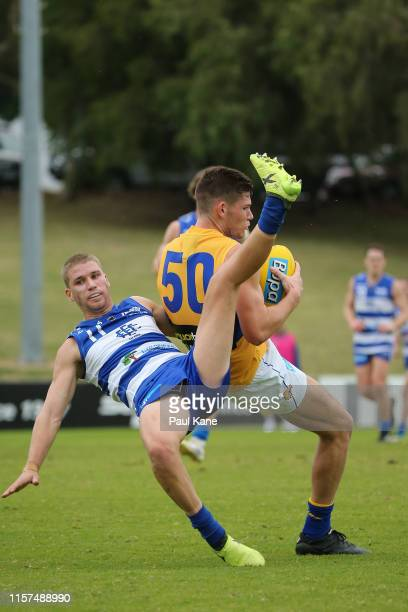 Matt Allen of the Eagles marks the ball against Morgan Davies of the Sharks during the round 11 WAFL match between the East Fremantle Sharks and West...