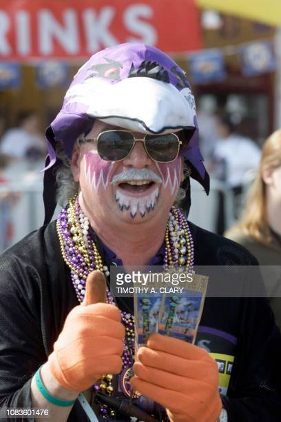 Matt Andrews a Baltimore Ravens fan gives a thumbs up as he displays two tickets for Super Bowl XXXV 28 January in Tampa Florida The New York Giants...
