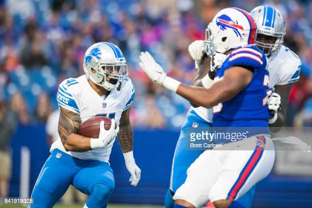 Matt Asiata of the Detroit Lions carries the ball during the preseason game against the Buffalo Bills on August 31 2017 at New Era Field in Orchard...