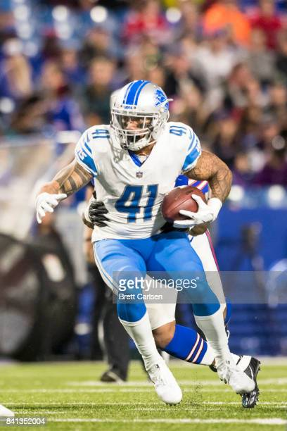 Matt Asiata of the Detroit Lions carries the ball during the second quarter of a preseason game against the Buffalo Bills on August 31 2017 at New...