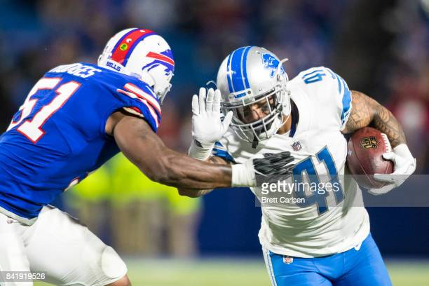 Matt Asiata of the Detroit Lions is brought down by Gerald Hodges of the Buffalo Bills during the preseason game on August 31 2017 at New Era Field...
