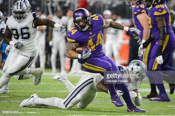 Matt Asiata of the Minnesota Vikings avoids a tackle by Damien Wilson of the Dallas Cowboys during the game on December 1 2016 at US Bank Stadium in...