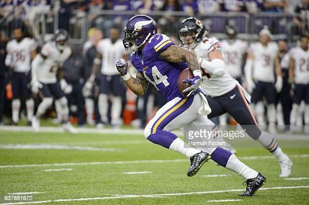 Matt Asiata of the Minnesota Vikings carries the ball against the Chicago Bears during the game on January 1 2017 at US Bank Stadium in Minneapolis...