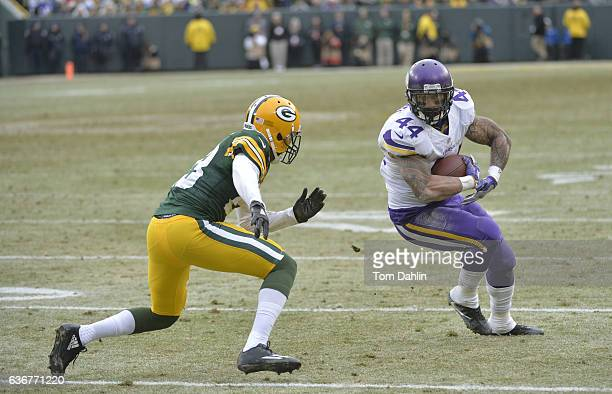 Matt Asiata of the Minnesota Vikings carries the ball during a game against the Green Bay Packers at Lambeau Field on December 24 2016 in Green Bay...