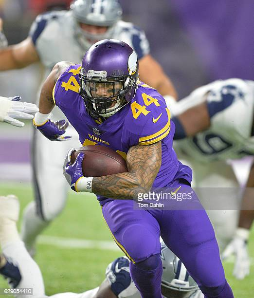 Matt Asiata of the Minnesota Vikings carries the ball during an NFL game against the Dallas Cowboys at US Bank Stadium December 1 2016 in Minneapolis...
