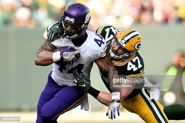 Matt Asiata of the Minnesota Vikings is brought down by Jake Ryan of the Green Bay Packers during the second quarter of a game at Lambeau Field on...