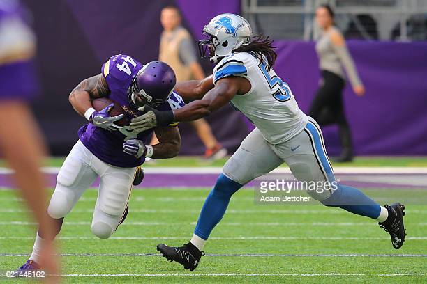 Matt Asiata of the Minnesota Vikings is tackled by Josh Bynes of the Detroit Lions during the first quarter of the game on November 6, 2016 at US...