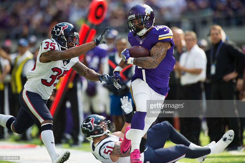 Matt Asiata #44 of the Minnesota Vikings pushes away Eddie Pleasant #35 of the Houston Texans after catching the ball for 23 yards on October 9, 2016 at US Bank Stadium in Minneapolis, Minnesota.