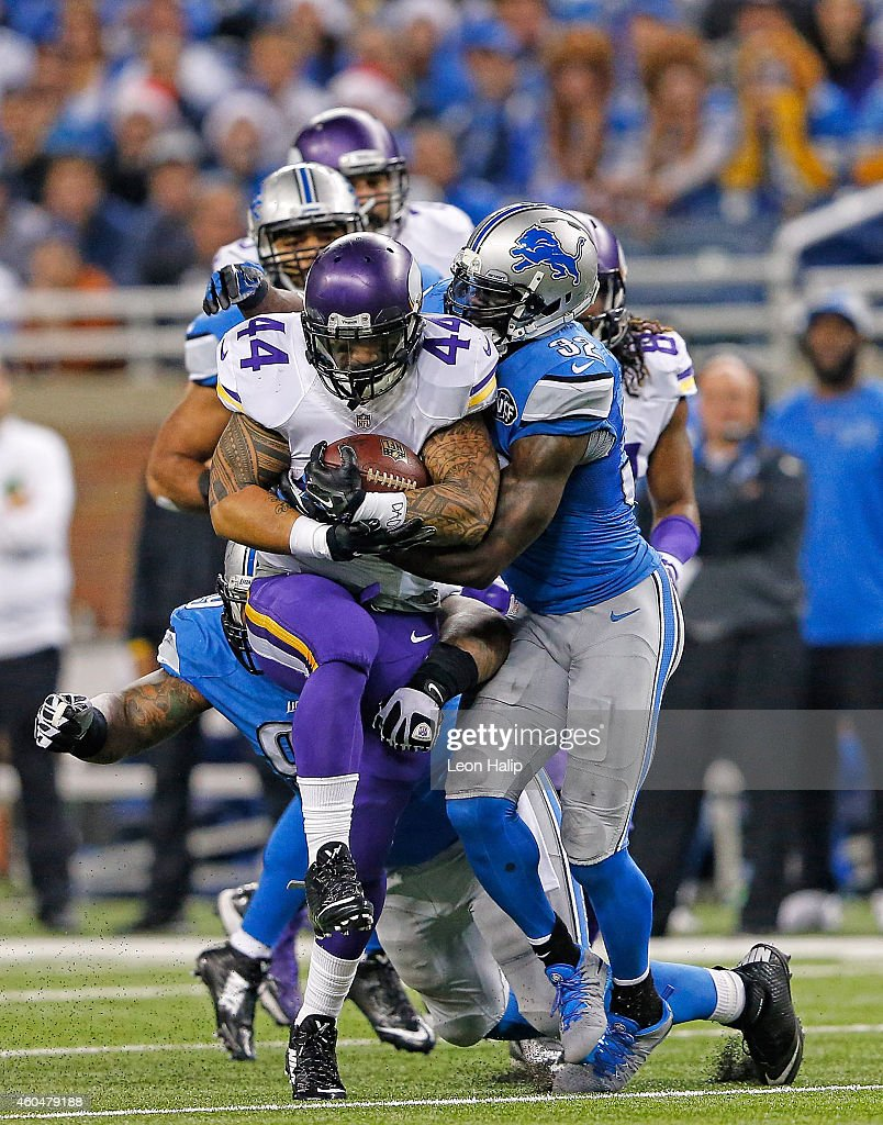 Matt Asiata #44 of the Minnesota Vikings runs for a first down during the second quarter of the game as James Ihedigbo #32 of the Detroit Lions makes the stop during the game at Ford Field on December 14, 2014 in Detroit, Michigan. The Lions defeated the Vikings 16-14.