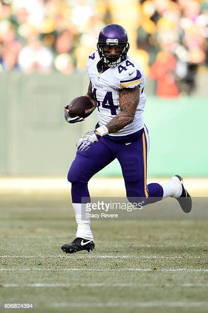 Matt Asiata of the Minnesota Vikings runs for yards during a game against the Green Bay Packers at Lambeau Field on December 24 2016 in Green Bay...