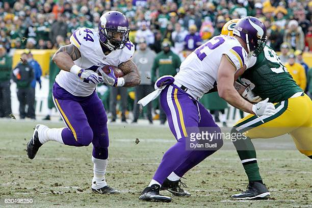 Matt Asiata of the Minnesota Vikings runs with the ball in the first quarter against the Green Bay Packers at Lambeau Field on December 24 2016 in...