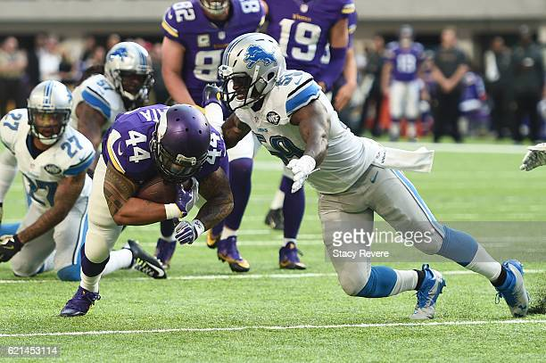 Matt Asiata of the Minnesota Vikings rushes the ball into Tahir Whitehead of the Detroit Lions during the second half of the game on November 6 2016...
