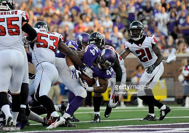 Matt Asiata of the Minnesota Vikings scores a touchdown against the Atlanta Falcons during the fourth quarter of the game on September 28, 2014 at...