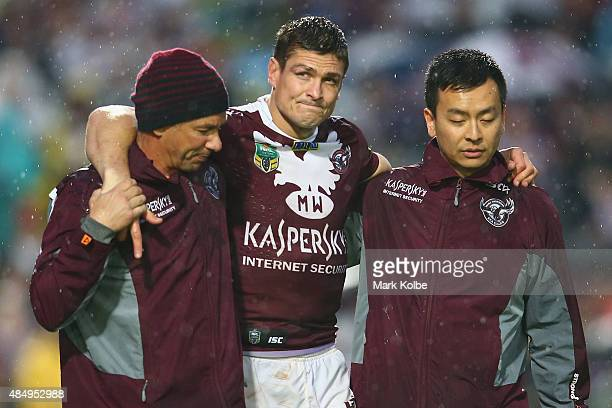 Matt Ballin of the Eagles leaves the field with the trainers during the round 24 NRL match between the Manly Warringah Sea Eagles and the Parramatta...