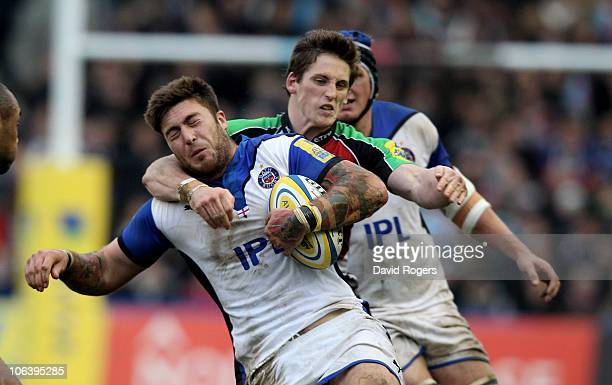 Matt Banahan of Bath is high tackled by Tom Williams during the Aviva Premiership match between Harlequins and Bath at the Stoop on October 31 2010...