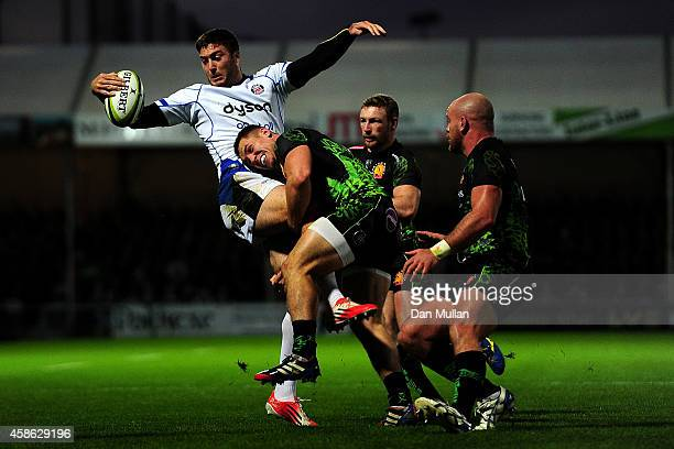 Matt Banahan of Bath is tackled by Sam Hill of Exeter Chiefs during the LV= Cup match between Exeter Chiefs and Bath Rugby at Sandy Park on November...