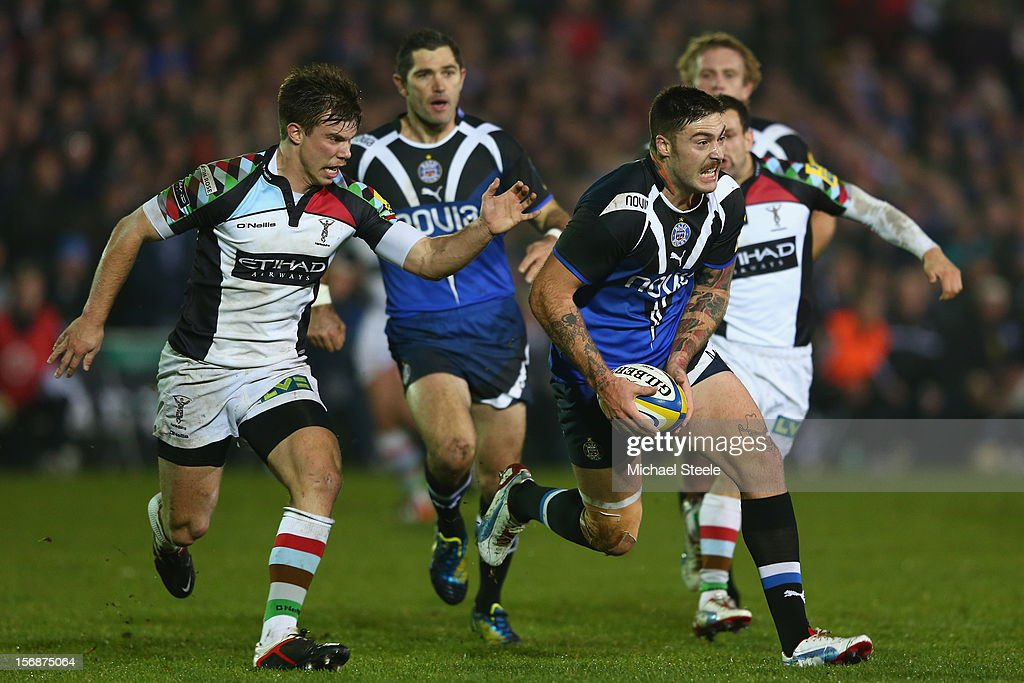 Matt Banahan (R) of Bath tracked by Sam Smith (L) of Harlequins during the Aviva Premiership match between Bath and Harlequins at the Recreation Ground on November 23, 2012 in Bath, England.