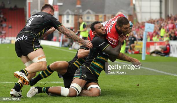 Matt Banahan of Gloucester is knocked into touch by Courtney Lawes during the Gallagher Premiership Rugby match between Gloucester Rugby and...