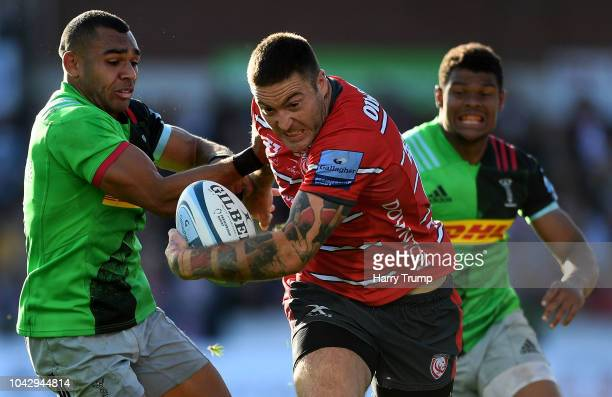 Matt Banahan of Gloucester Rugby is tackled by Joe Marchant of Harlequins during the Gallagher Premiership Rugby match between Gloucester Rugby and...