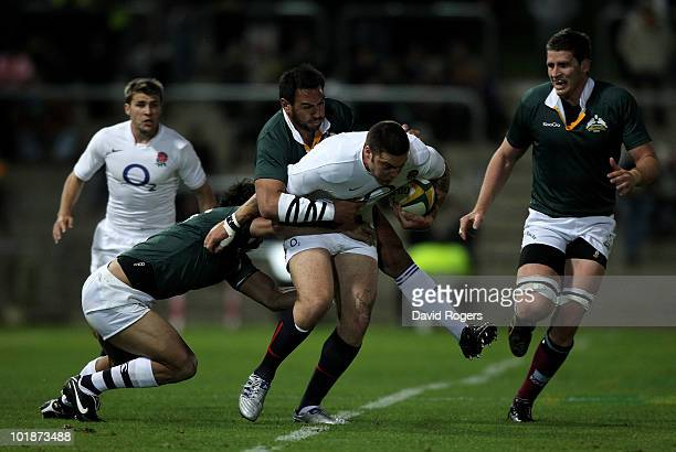 Matt Banahan, the England wing, is stopped by the Australian defence during the match between the Australian Barbarians and England at the Members...