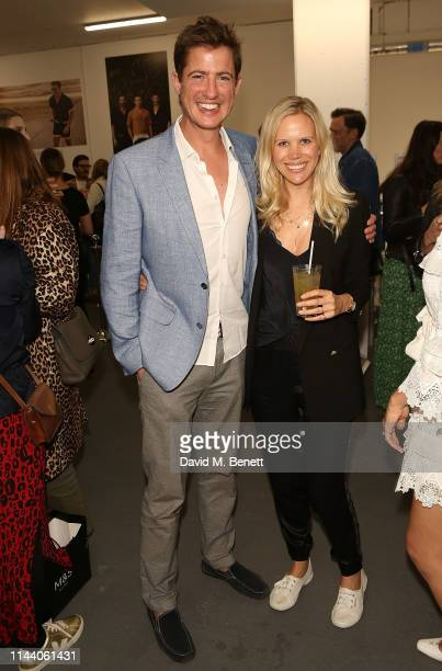 Matt Barber and Lial Barber attend the launch of Oliver Cheshire's new resort wear collection 'CHE' on May 16 2019 in London England