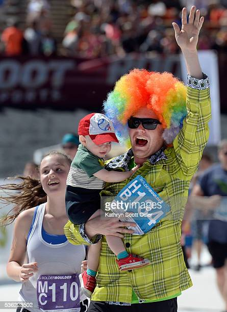 Matt Barber of Denver and son Bridger make their way to the finish line The 38th BolderBOULDER takes place along Boulder's streets with the finish...