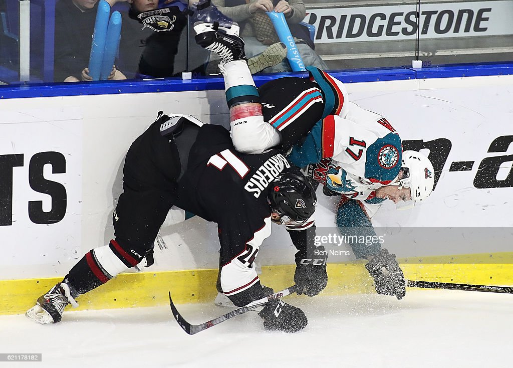 Matt Barberis #24 of the Vancouver Giants hip checks Rooney Southam #17 of the Kelowna Rockets during the second period of their WHL game at the Langley Events Centre on November 4, 2016 in Langley, British Columbia, Canada.