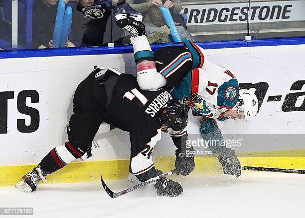 Matt Barberis of the Vancouver Giants hip checks Rooney Southam of the Kelowna Rockets during the second period of their WHL game at the Langley...