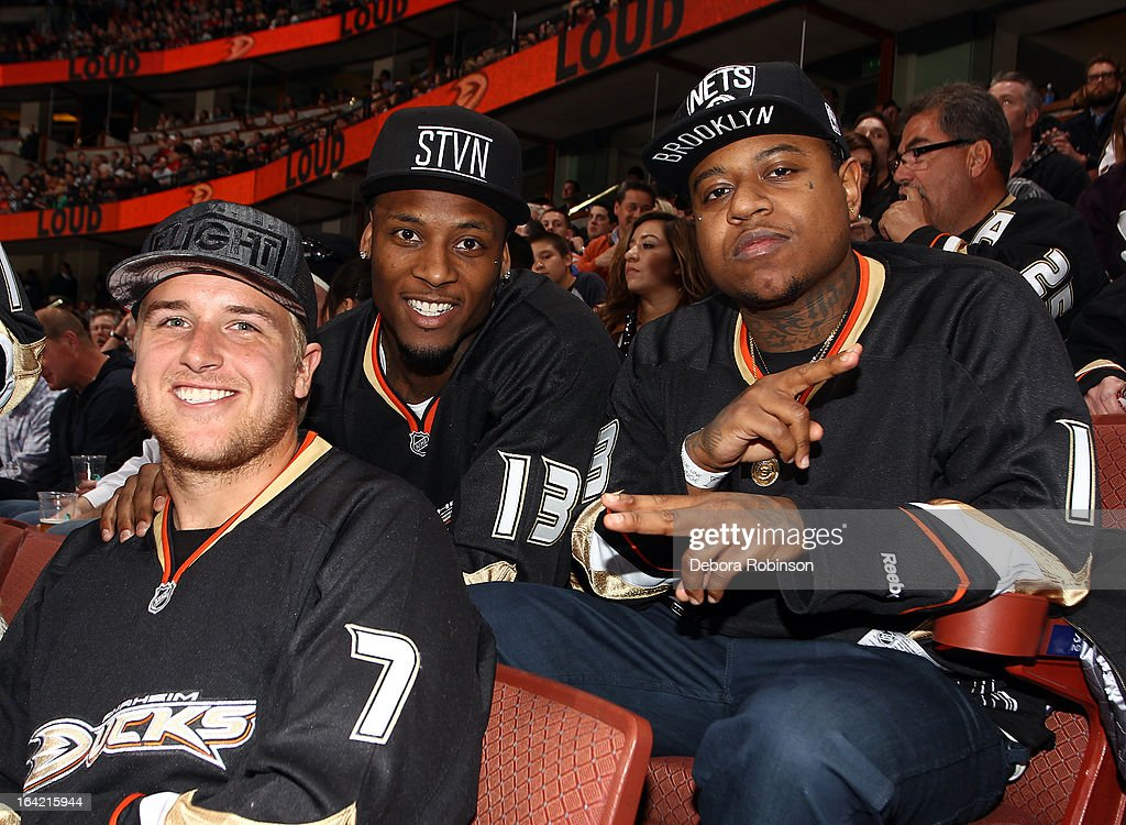 Matt Barkley, Stevie Johnson and Ya Boy pose for a photo during the game between the Anaheim Ducks and the Chicago Blackhawks on March 20, 2013 at Honda Center in Anaheim, California.