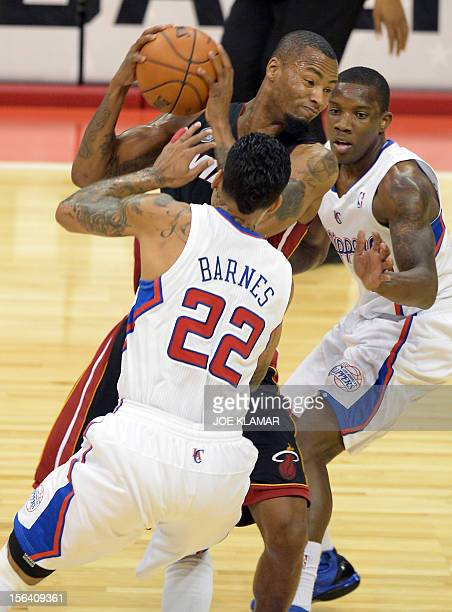 Matt Barnes and Eric Bledsoe of Clippers and Rashard Lewis of Heat fight for a ball during the NBA game between Los Angeles Clippers and Miami Heat...