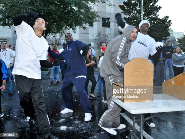 Matt Barnes Brandon Bass Ryan Anderson and Dwight Howard of the Orlando Magic participate in a snowball fight during a holiday party for 42 families...
