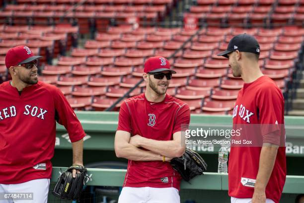 Matt Barnes Chris Sale and Rick Porcello of the Boston Red Sox talk before a game against the Chicago Cubs on April 29 2017 at Fenway Park in Boston...