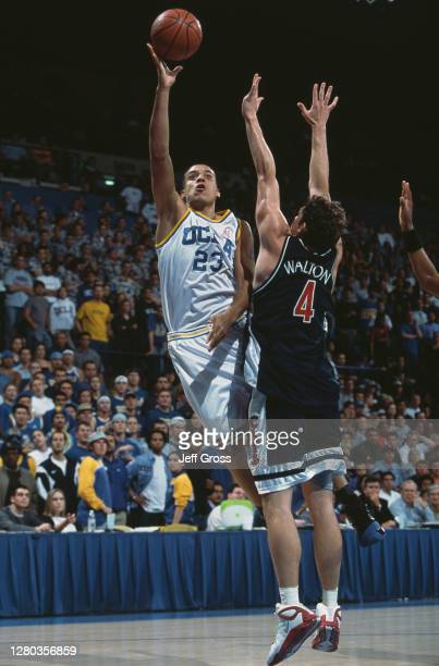 Matt Barnes, Forward for the University of California, Los Angeles UCLA Bruins drives to the basket over Luke Walton of the University of Arizona...