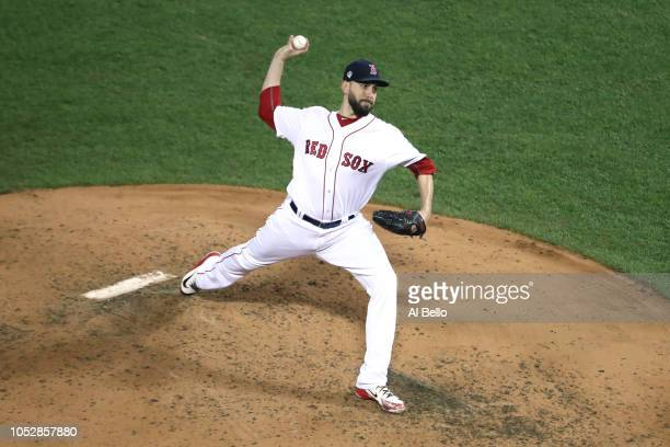 Matt Barnes of the Boston Red Sox delivers the pitch during the fifth inning against the Los Angeles Dodgers in Game One of the 2018 World Series at...