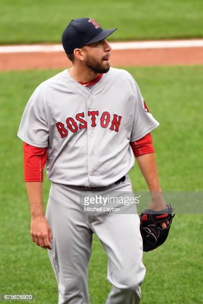 Matt Barnes of the Boston Red Sox pitches walks back to the dug out during a baseball game against the Baltimore Orioles at Oriole Park at Camden...
