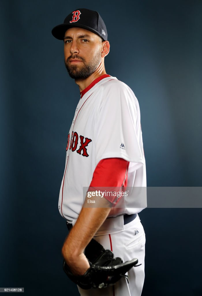 : Matt Barnes #32 of the Boston Red Sox poses for a portrait during the Boston Red Sox photo day on February 20, 2018 at JetBlue Park in Ft. Myers, Florida.