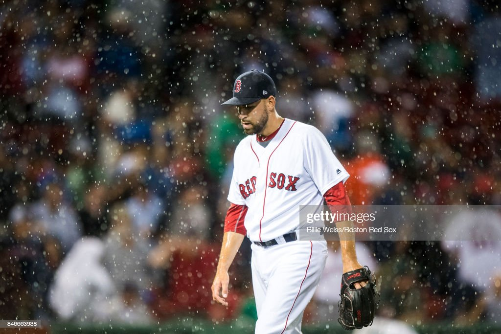 Matt Barnes #68 of the Boston Red Sox reacts as rain falls during the seventh inning of a game against the Oakland Athletics on September 13, 2017 at Fenway Park in Boston, Massachusetts.