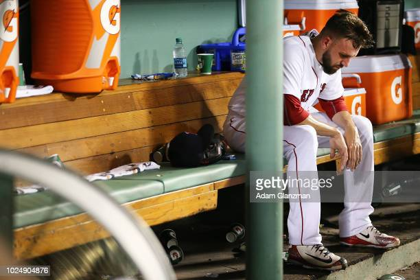 Matt Barnes of the Boston Red Sox reacts in the dugout after being pulled from the game after giving up backtoback home runs to JT Realmuto and...