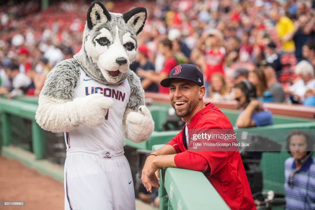 Matt Barnes #68 of the Boston Red Sox reacts with the University of Connecticut mascot before a game against the Cleveland Indians on August 14, 2017 at Fenway Park in Boston, Massachusetts.