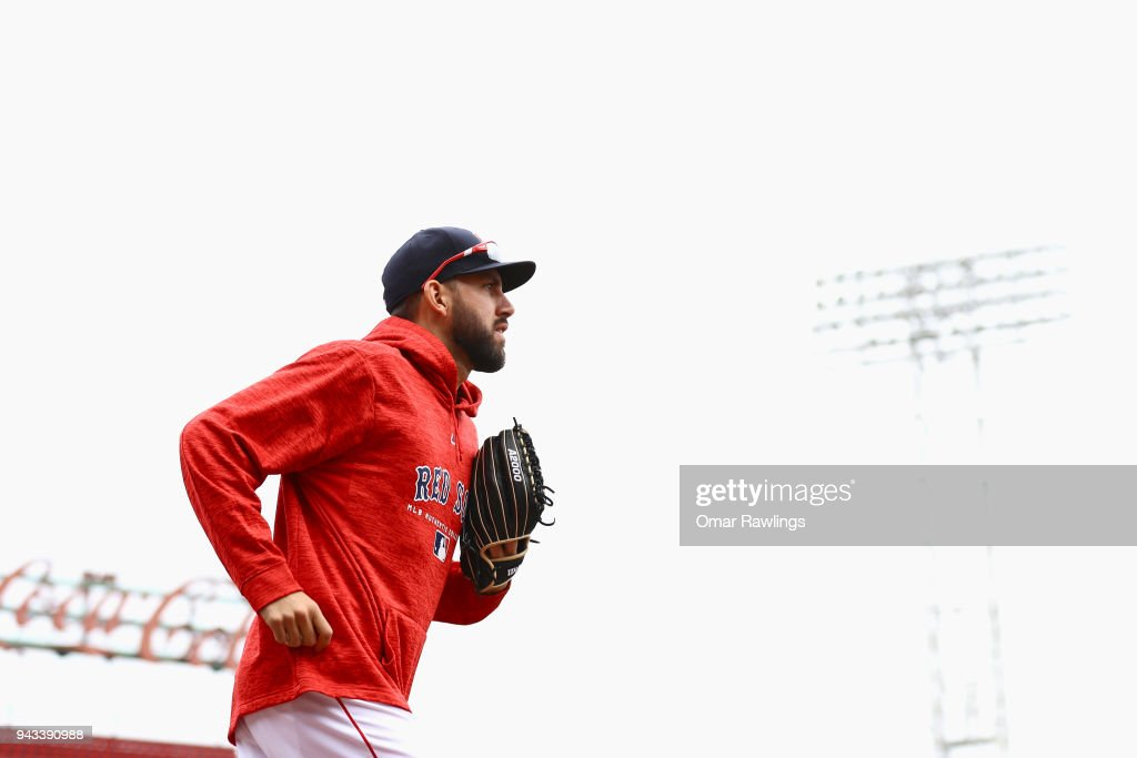 Matt Barnes #32 of the Boston Red Sox runs out of the dugout before the game against the Tampa Bay Rays at Fenway Park on April 8, 2018 in Boston, Massachusetts.