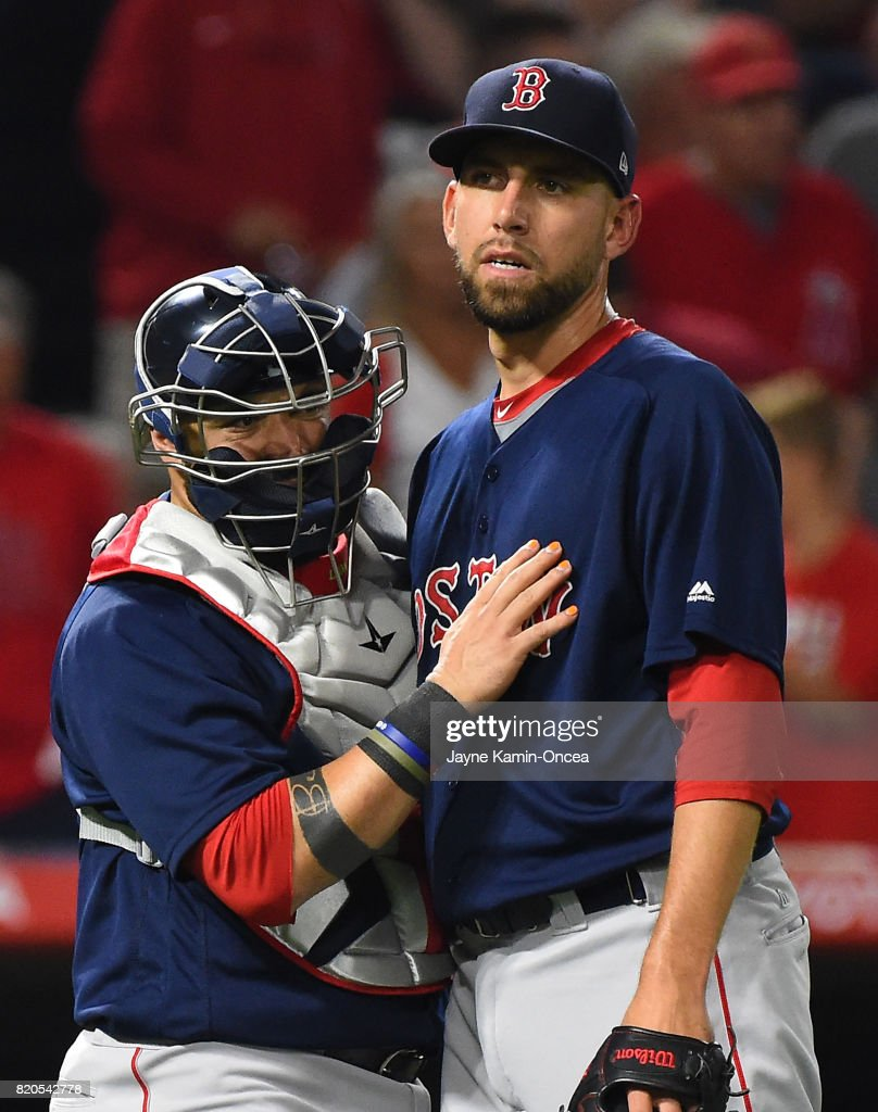 Matt Barnes #68 of the Boston Red Sox shakes hands with Sandy Leon #3 after earning a save in the ninth inning in the game against the Los Angeles Angels at Angel Stadium of Anaheim on July 21, 2017 in Anaheim, California.