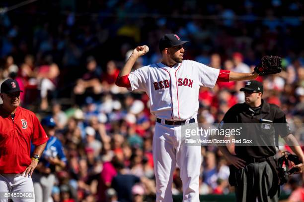 Matt Barnes of the Boston Red Sox throws a practice pitch after being hit in the hand with a ground ball during the eighth inning of a game against...