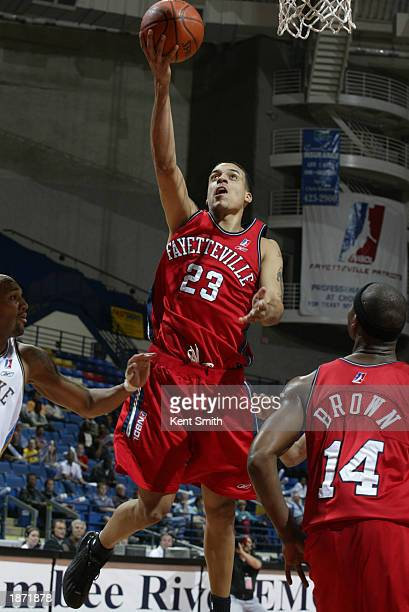 Matt Barnes of the Fayetteville Patriots drives against the Roanoke Dazzle during the NBDL Playoffs at the Crown Coliseum on March 25, 2003 in...