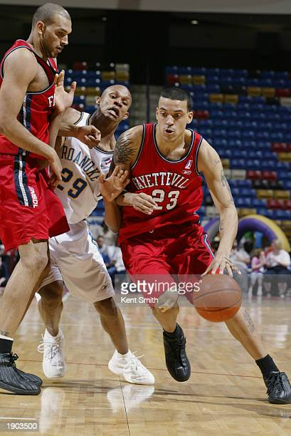 Matt Barnes of the Fayetteville Patriots drives around the screen persued by George Williams of the Roanoke Dazzle during Game One of the NBDL...