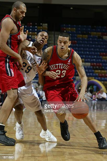 Matt Barnes of the Fayetteville Patriots drives past George Williams of the Roanoke Dazzle during the NBDL Playoffs at the Crown Coliseum on March...