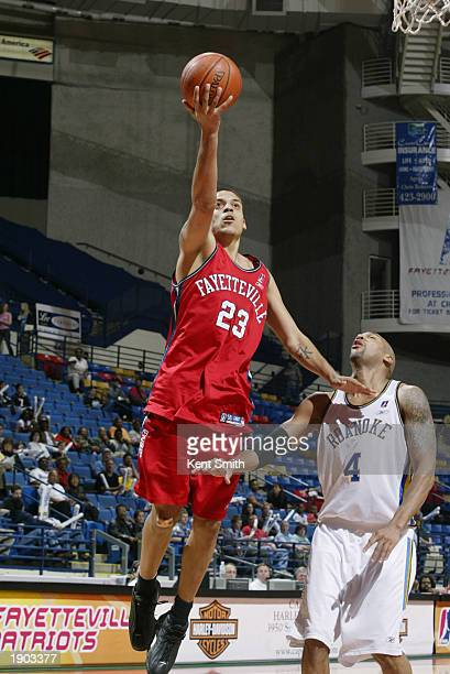 Matt Barnes of the Fayetteville Patriots shoots a layup past Jamal Robinson of the Roanoke Dazzle during Game One of the NBDL Semifinals at the Crown...