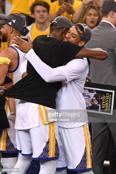 Matt Barnes of the Golden State Warriors celebrates with Kevin Durant of the Golden State Warriors after defeating the Cleveland Cavaliers in Game...
