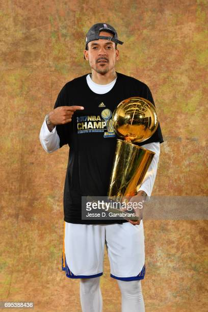 Matt Barnes of the Golden State Warriors poses for a portrait with the Larry O'Brien Trophy after defeating the Cleveland Cavaliers in Game Five of...