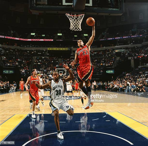 Matt Barnes of the Golden State Warriors takes the ball to the basket against Dahntay Jones of the Memphis Grizzlies during a game at the FedExForum...